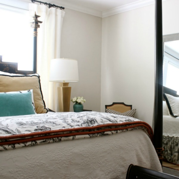 Benjamin Moore Natural Cream paint color on bedroom designed by Sherry Hart.