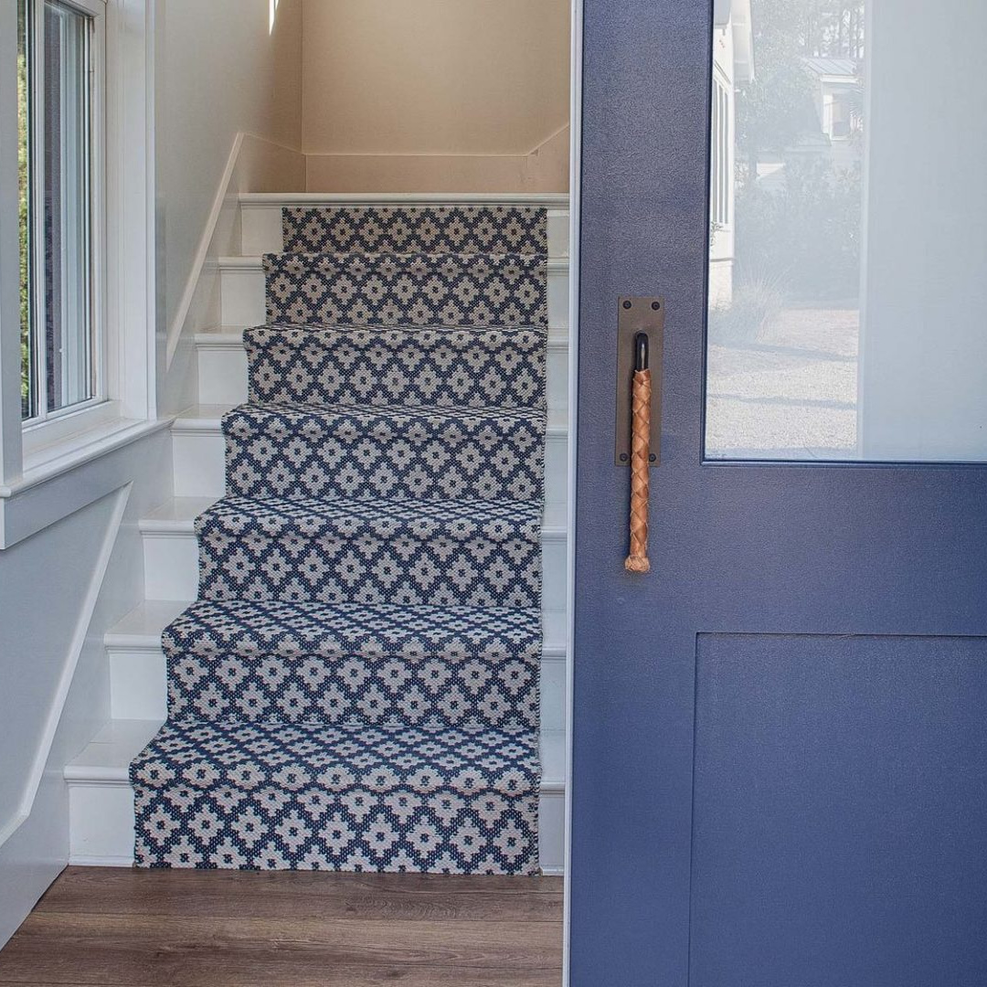 Blue patterned stair runner and blue door in a coastal cottage by Lisa Furey. #bluedecor #bluepaint #bluedoor #bluecarpet #stairrunner #coastalstyle