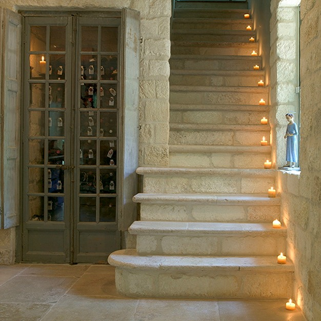 Stone staircase and reclaimed rustic wood doors - Chateau Domingue.