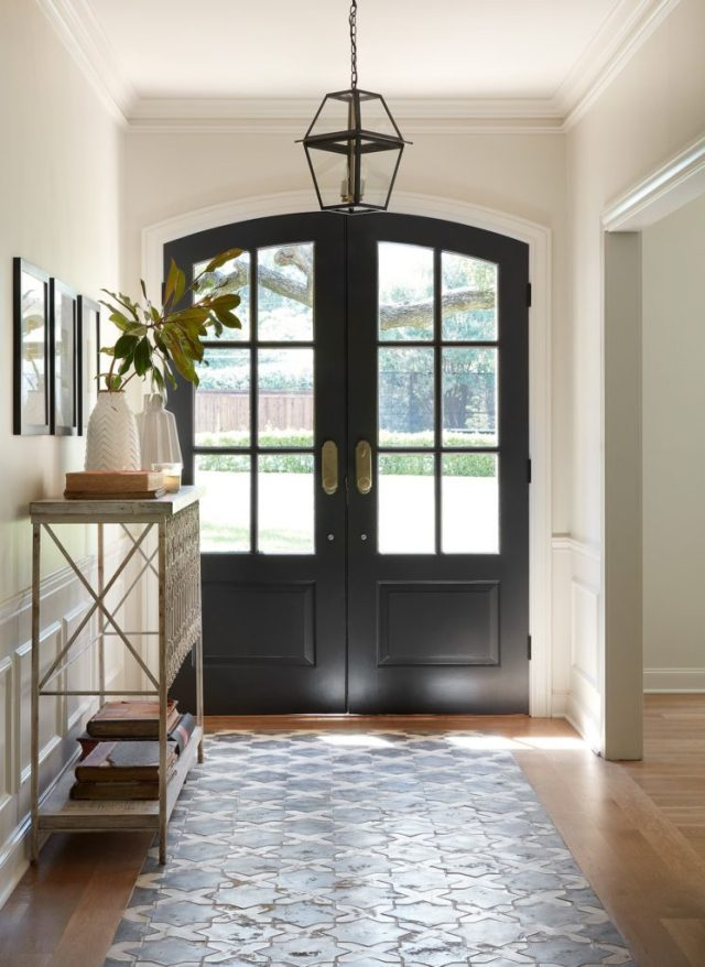 Fixer Upper Club House episode featured this stunning French country inspired entry with beautiful arched black doors and encaustic tile flooring. #theclubhouse #fixerupper #entryway #frenchcountry #interiordesign #joannagaines