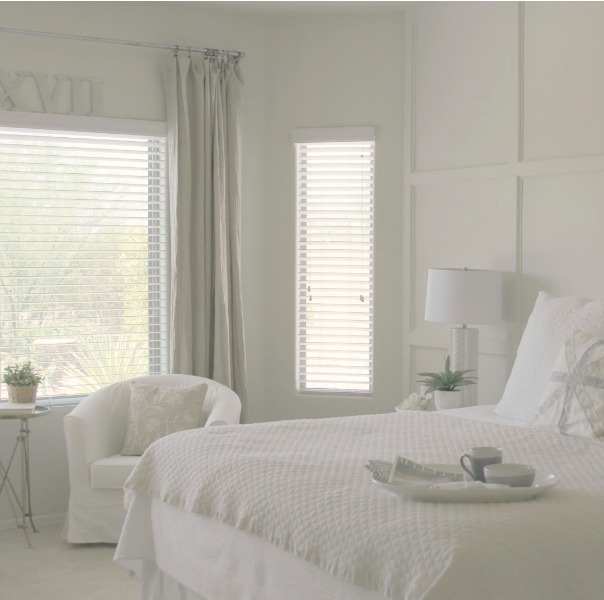 Valspar Salute paint color in a serene and sunny white bedroom in Arizona with board and batten panel wall and sliding modern barn door. Hello Lovely Studio. Come Tour 16 Soothing Paint Colors for a Tranquil Bedroom Retreat!