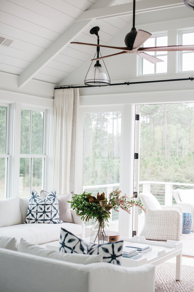 White living room in coastal cottage in Palmetto Bluff. Design by Lisa Furey.