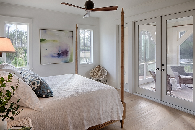 Coastal cottage bedroom with attached porch. Design by Lisa Furey.