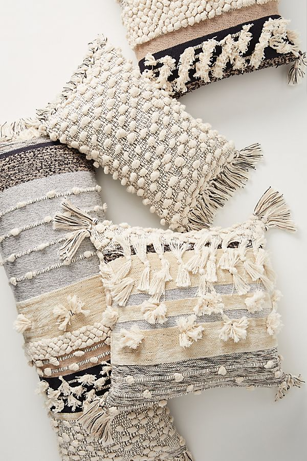 All Roads Yucca Pillows from Anthropologie - French Farmhouse Decor on Fixer Upper Get the Look The Club House Family Room with Shopping Resources as well as Design Ideas.