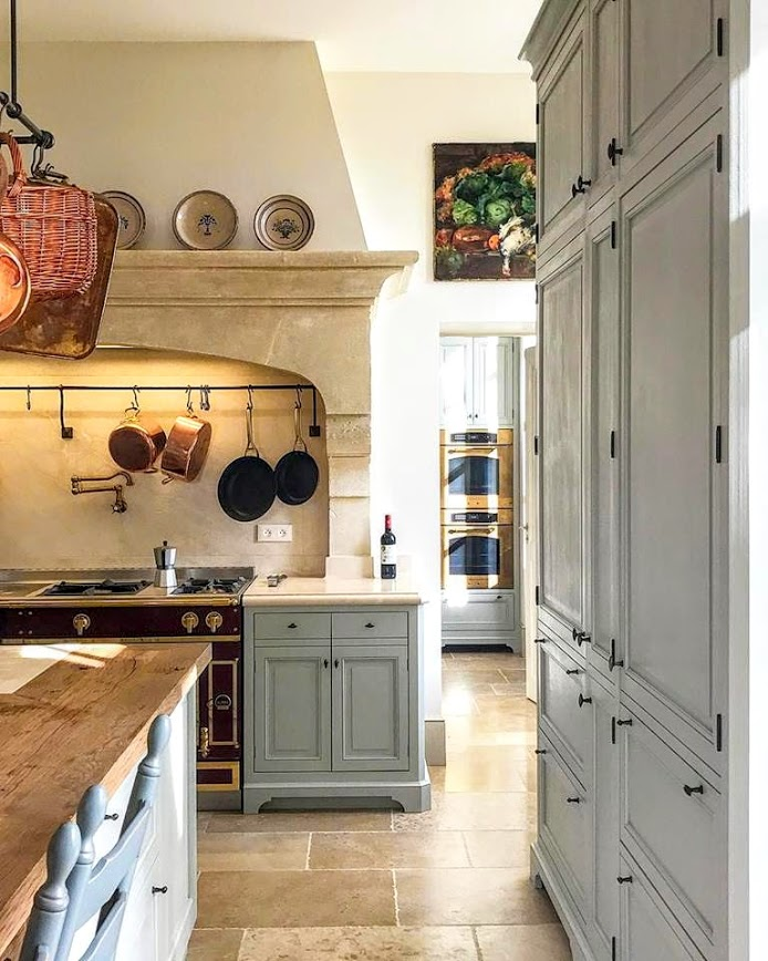 Blue painted kitchen cabinets in French kitchen in Le Mas de Poirers Provence French farmhouse. Come see 24 Inspiring European Country Kitchen Ideas!