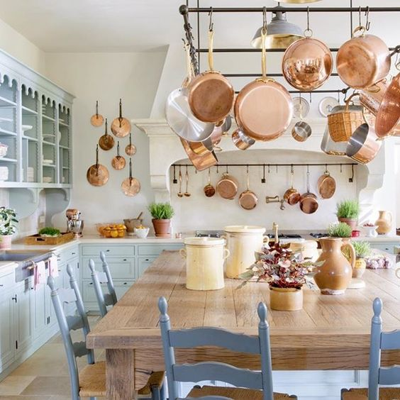 Magnificent Provence France kitchen with copper pots and blue painted cabinets! Le Mas des Poirers. Come see 24 Inspiring European Country Kitchen Ideas!