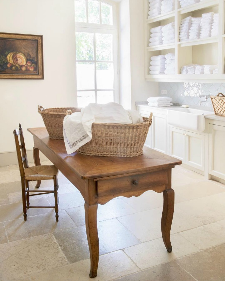 Laundry room in Le Mas de Poirers Provence French farmhouse. Come enjoy more Dreamy Laundry Room Inspiration to Re-imagine a Timeless Tranquil Design!