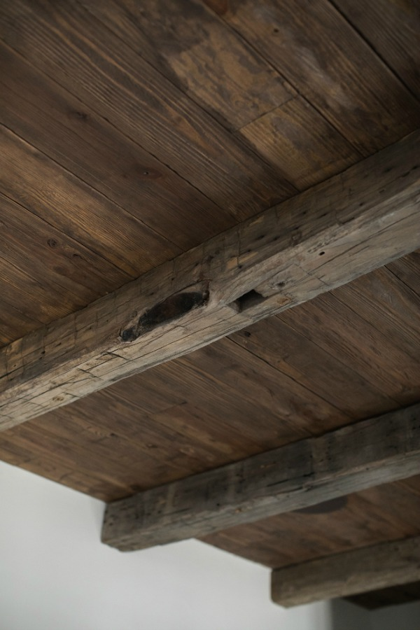 Rustic and dark reclaimed wood and cedar ceiling. Brit Jones Design.