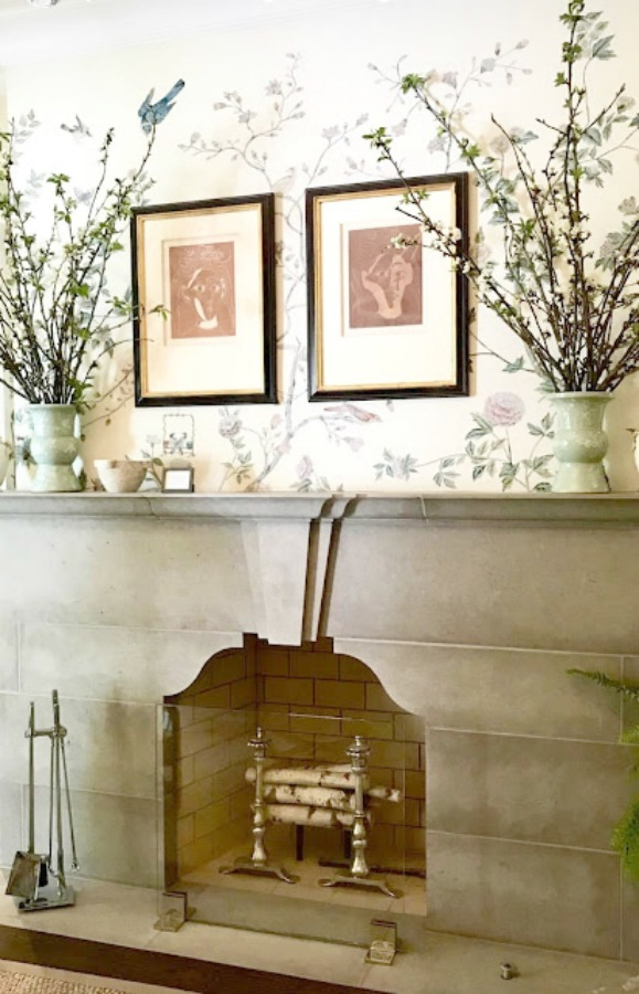 Living room with geometric limestone mantel. Interior Design: Beth Webb. Wallpaper: Iksel ...
