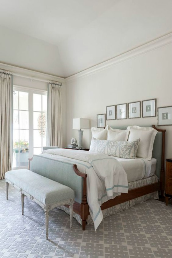 Tranquil bedroom with soft blue accents and neutral color scheme by designer Collins Interiors.