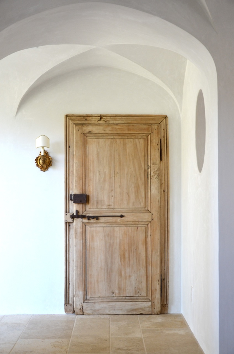 Patina Farm laundry room door and vintage sconce - design by Brooke Giannetti.