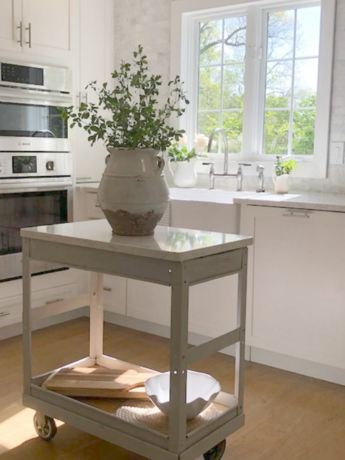 Serene Tranquil White Kitchen With Farm Sink, Marble Subway Tile, Viatera  Minuet Quartz Counters ...