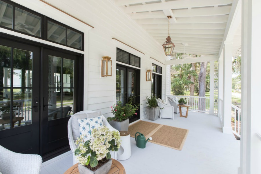 Covered front porch. Modern Coastal Cottage Design Inspiration in 2018 Coastal Living Idea House. Design by Jenny Keenan and architecture by Eric Moser.