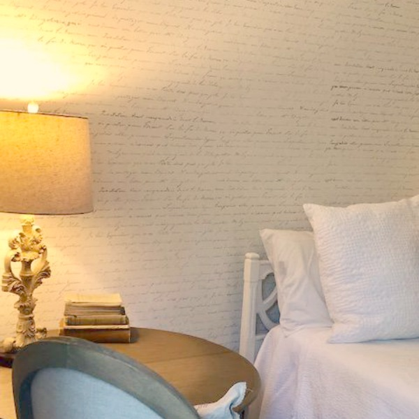 DIY Chic French Script Stenciled Accent Wall. Country French farmhouse style bedroom with French script stenciled wall by Hello Lovely Studio. #frenchcountry #frenchfarmhouse #frenchscript #diy #stenciledwall