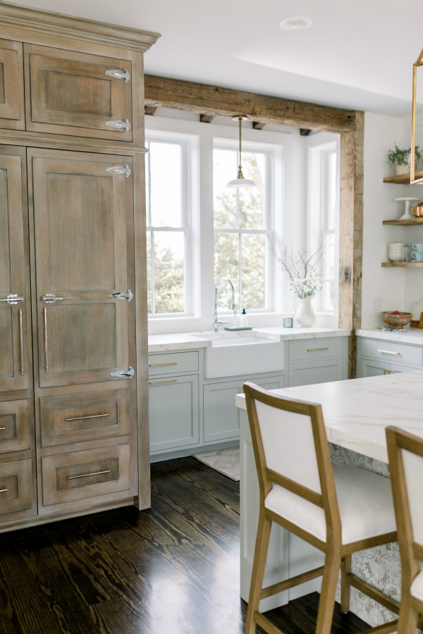 Elegant white farmhouse kitchen with Benjamin Moore Repose Grey cabinets, subway tile, gold accents, and reclaimed barn wood. Design: Finding Lovely. Wall color: Benjamin Moore Chantilly Lace.