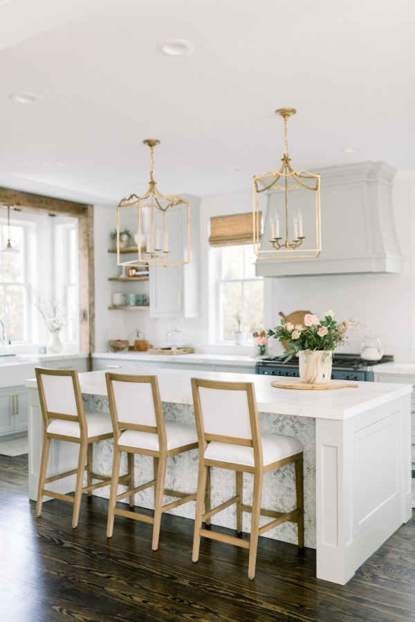 Elegant white farmhouse kitchen with Benjamin Moore Repose Grey cabinets, subway tile, gold accents, and reclaimed barn wood. Design: Finding Lovely. Come see Timeless Tranquil White & Grey Kitchen Tour. Wall color: Benjamin Moore Chantilly Lace.