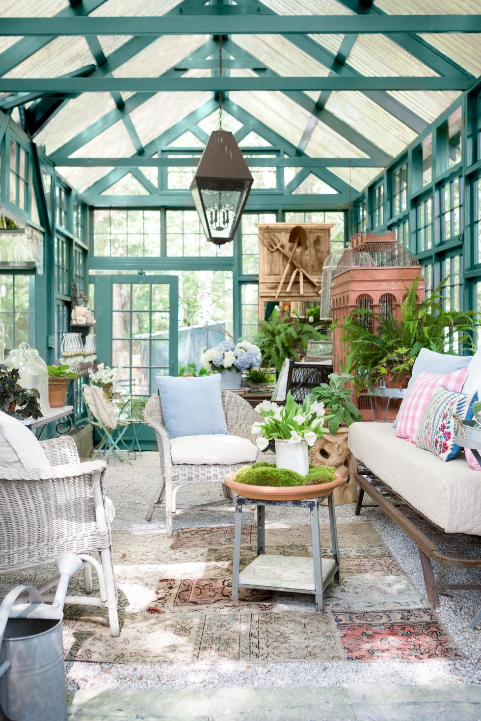 Chic she shed garden retreat with luxurious interior in backyard by Susanne Hudson. Green trim is painted Benjamin Moore Tarrytown Green.