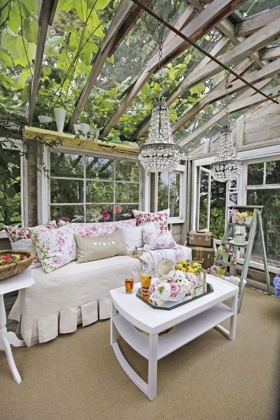 Glamorous backyard chic she shed greenhouse with darling furniture and crystal chandelier. #sheshed #greenhouse #backyardoasis #shabbychic #sheds