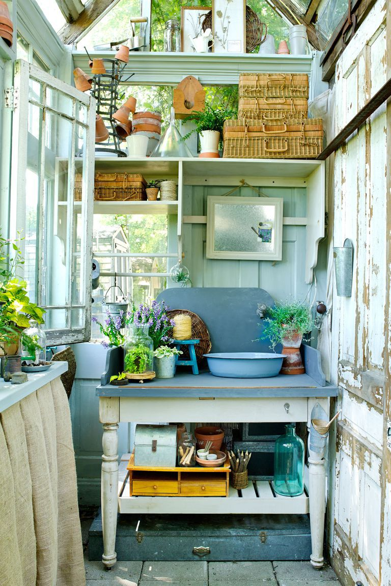 Interior of a charming chic Shed Shed by Donna Jenkins of The Tinker House Trading Company in Country Living. Come explore She Shed Chic, Potting Shed & Backyard Inspiration.