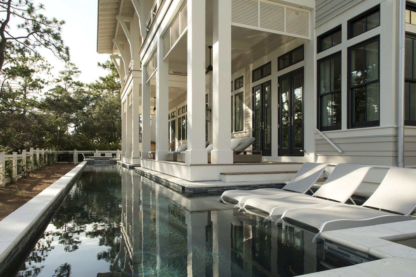 Luxurious pool design inspiration from a magnificent coastal style classic home by architect Geoff Chick. #luxurypool #pooldesign #coastalstyle