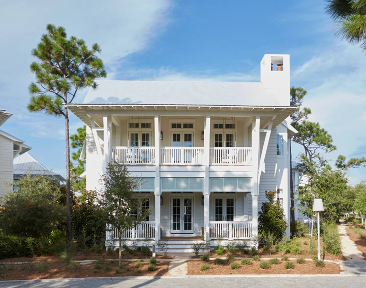 Magnificent exterior of a coastal home by Geoff Chick & Associates.Come discover  White Homes + A Few Bright White Exterior Paint Colors#coastalhome #coastalarchitecture #traditionalhome