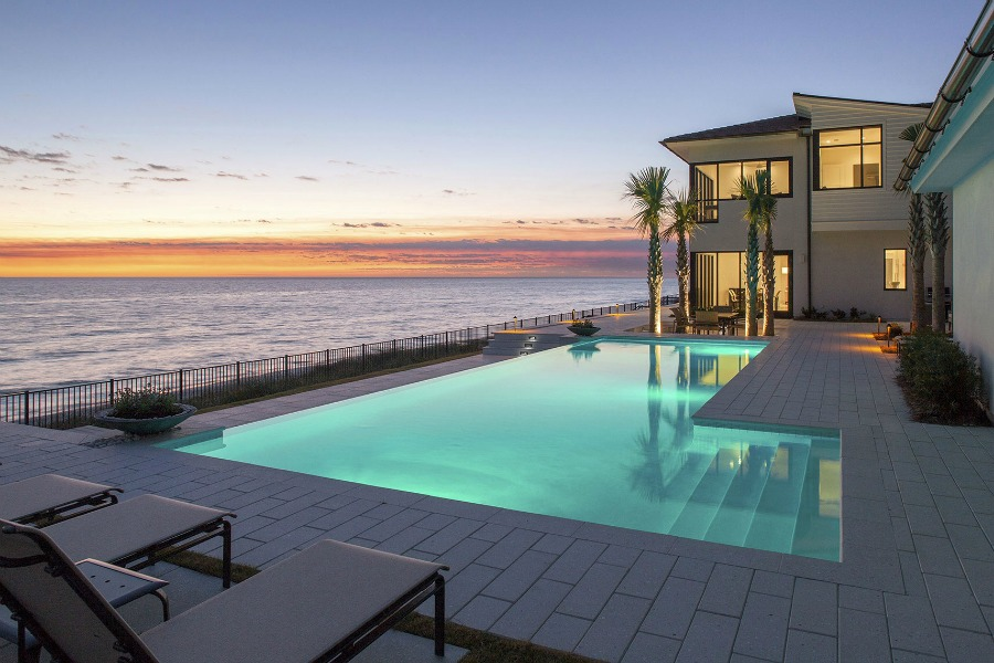 Luxurious pool design inspiration from a magnificent coastal style classic home by architect Geoff Chick. #beachhouse #coastalstyle #pooldesign #luxurypool