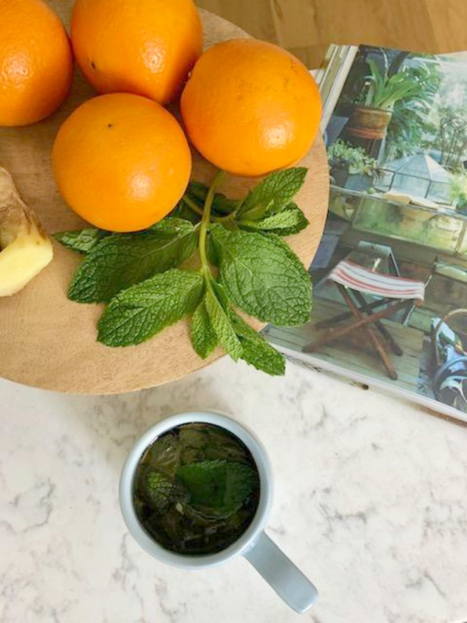 Ingredients for fresh mint tea in my white kitchen - Hello Lovely Studio.