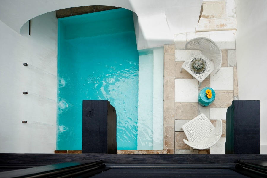 Aerial view of magnificent pool design by Jeffrey Dungan on Hello Lovely Studio.