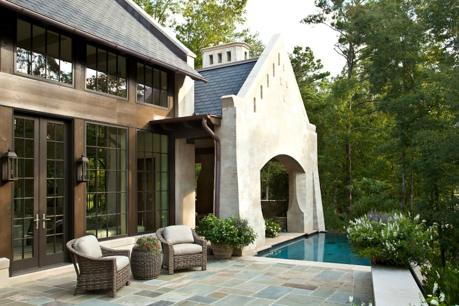 Breathtaking view of magnificent home and pool with design by Jeffrey Dungan on Hello Lovely Studio.