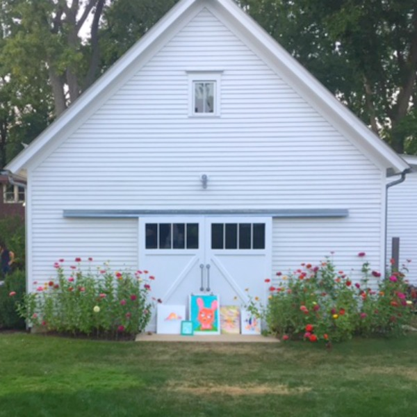 Modern farmhouse garage with sliding barn doors and zinnia flowers. Hello Lovely Studio. Art by Jenny Sweeney. Come explore She Shed Chic, Potting Shed & Backyard Inspiration.