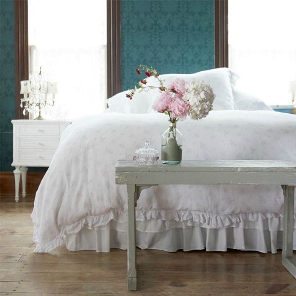 Teal walls in a shabby chic style bedroom designed by Rachel Ashwell.