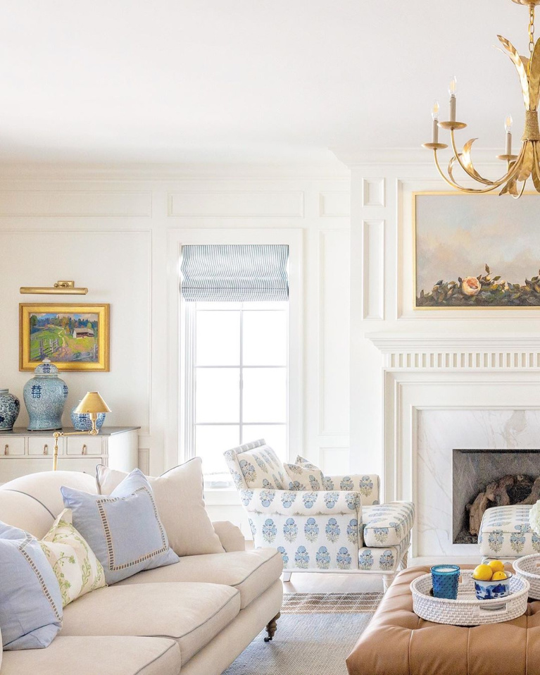 Gorgeous blue and white family room with pale tones and magnificent architecture by The Fox Group. #thefoxgroup #familyroom #interiordesign #blueandwhite #traditionalstyle #classicdesign