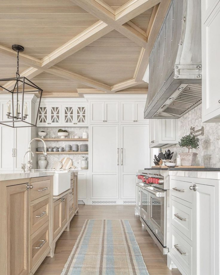 Modern farmhouse white kitchen with beautiful wood ceiling detail and breathtaking architectural design - The Fox Group. #modernfarmhouse #thefoxgroup #kitchendesign #woodceiling #traditionalkitchens #twotonekitchen #zinchood #whitekitchens