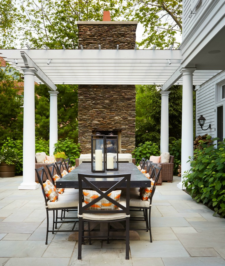 Magnificent pergola with outdoor dining and design by Tom Stringer on Hello Lovely Studio.