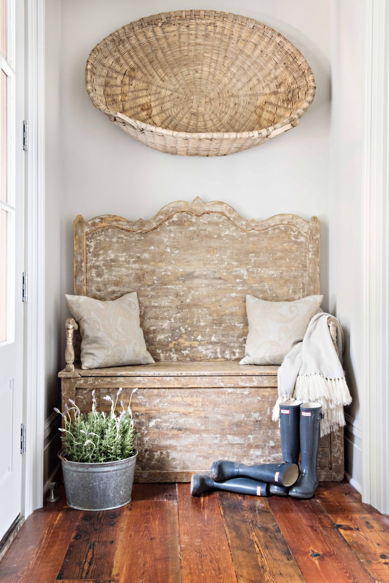 Rustic French farmhouse style in an entry with a weathered bench, boots, bucket, and basket! Kelli Boyd Photography. Come enjoy Traditional Laundry Room and Mud Room Design Ideas, Resources, and Humor Quotes!