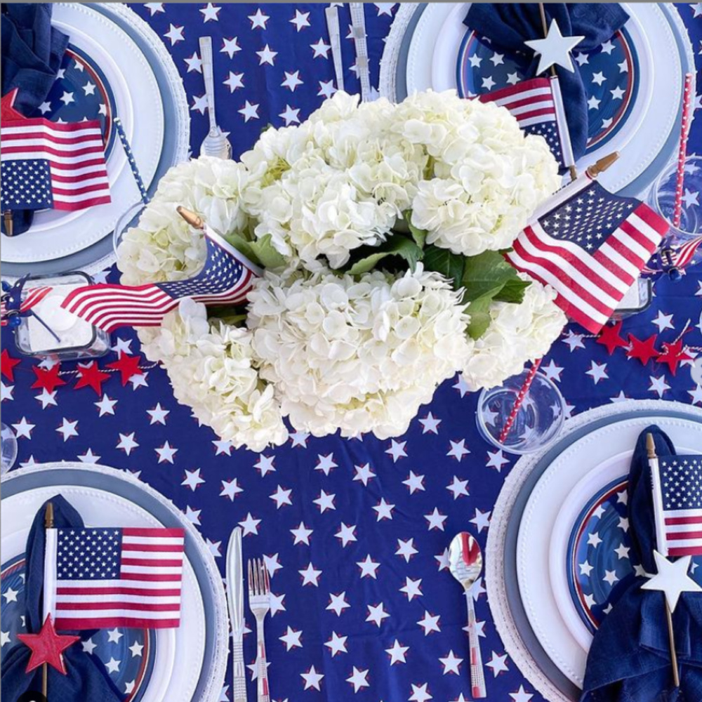Festive and patriotic American tablescape with flags, stars, hydrangea and 4th of July style - @arayofbliss