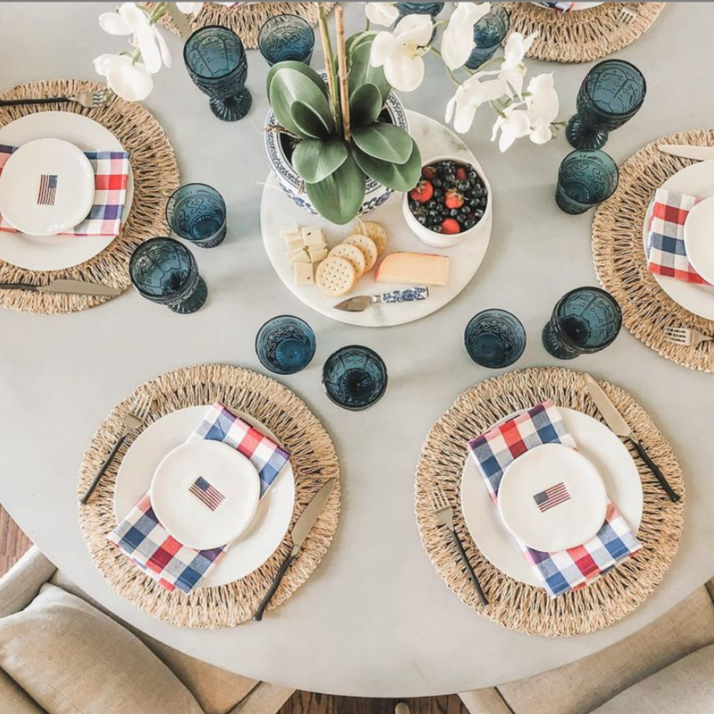 Gorgeous tablescape for July 4th with American flag plates from Williams-Sonoma - @jchildressinteriors. #tablescapes #4thofjuly #independenceday #july4 #americanflag