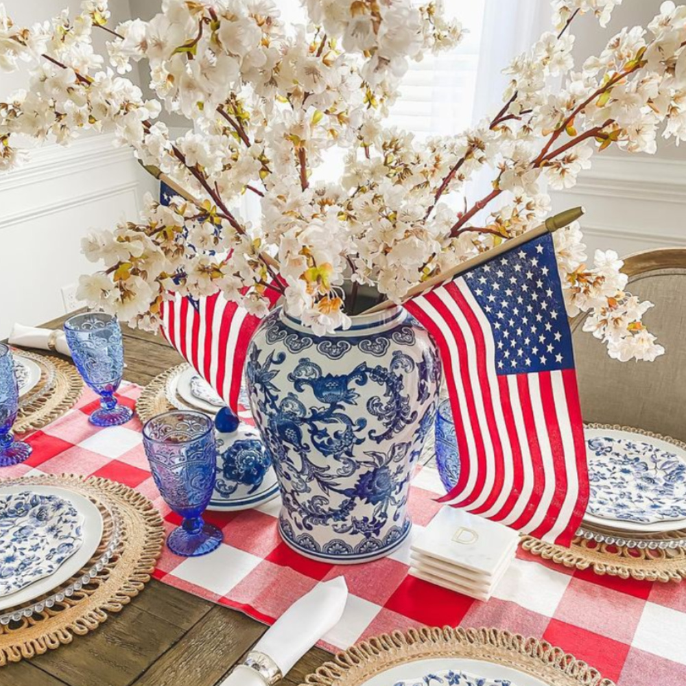 Beautiful 4th of July tablescape with gingham runner and red, white, and blue - @autumnraedavis.