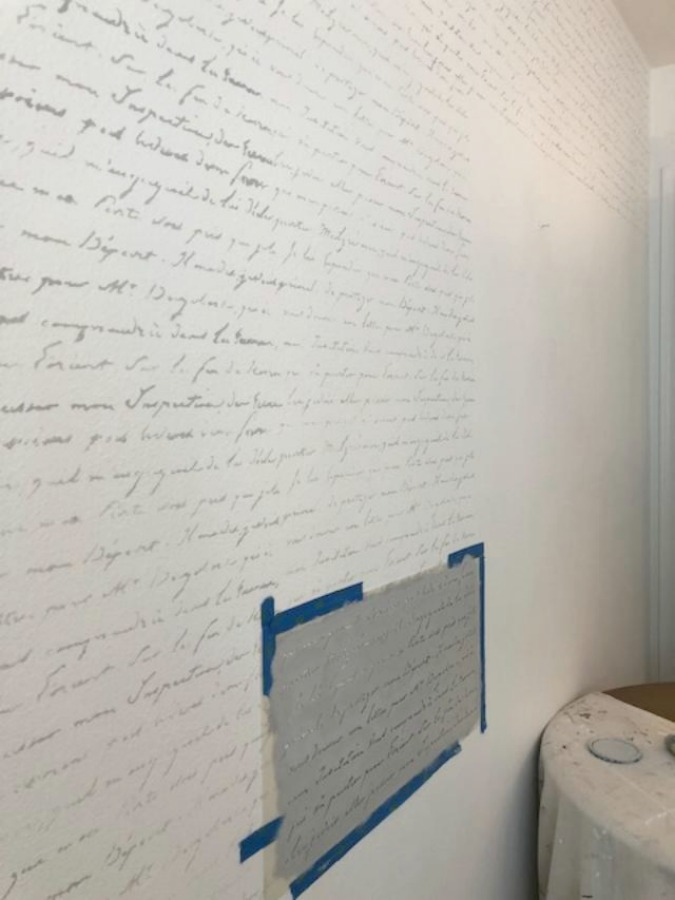 DIY Chic French Script Stenciled Accent Wall. French script stencil statement wall - Hello Lovely Studio.