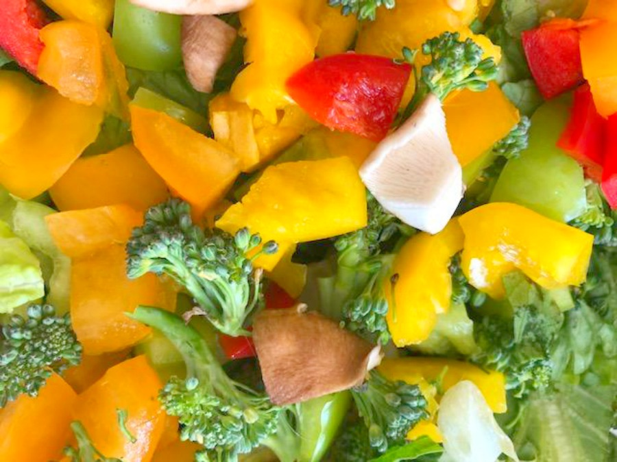 Fresh colorful summer vegetable salad - Hello Lovely Studio.