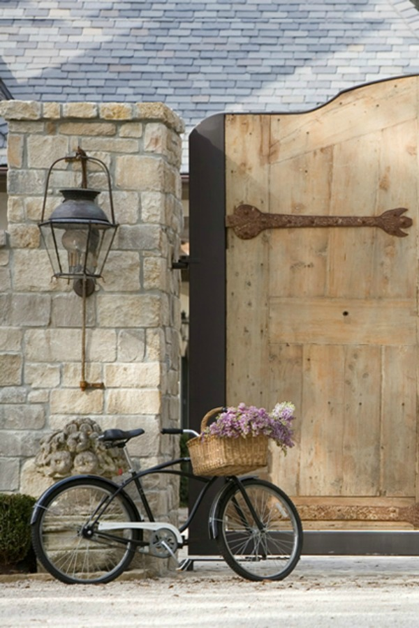 Exquisite French country chateau gates and vintage bicycle with basket - Chateau Domingue. Come explore French Country Basket Inspiration: Resources for Rustic, French Market, and Boulangerie as well as photos to Inspire!