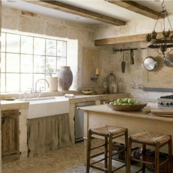 Chateau Domingue. Proprietor Ruth Gay's Tuscan country manor style kitchen is a revelation…certainly rustic and refined indeed! Linen softens the apron front sink and walls created with French Limestone Bugets as well as reclaimed cobblestone flooring.