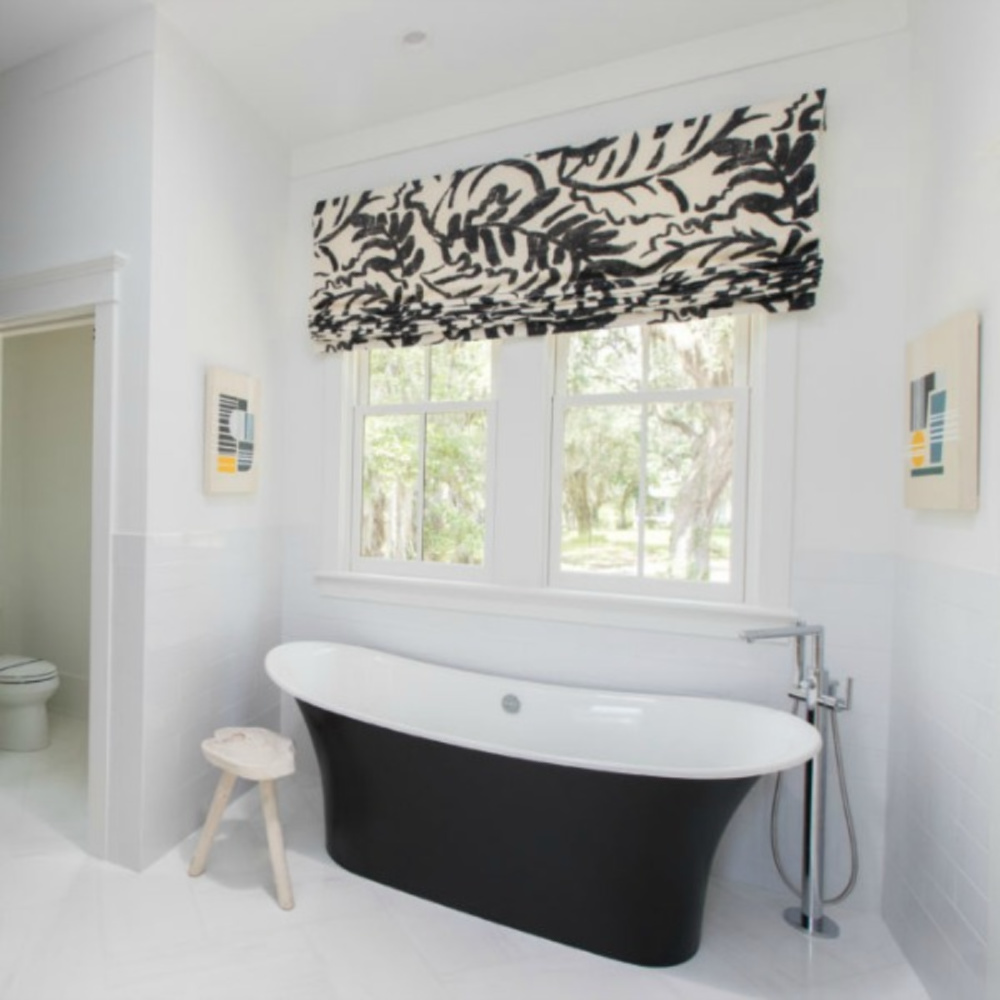 Classic black and white bathroom with soaker tub in a coastal living showhouse with design by Jenny Keenan. #coastalstyle #bathroomdesign #blackandwhite
