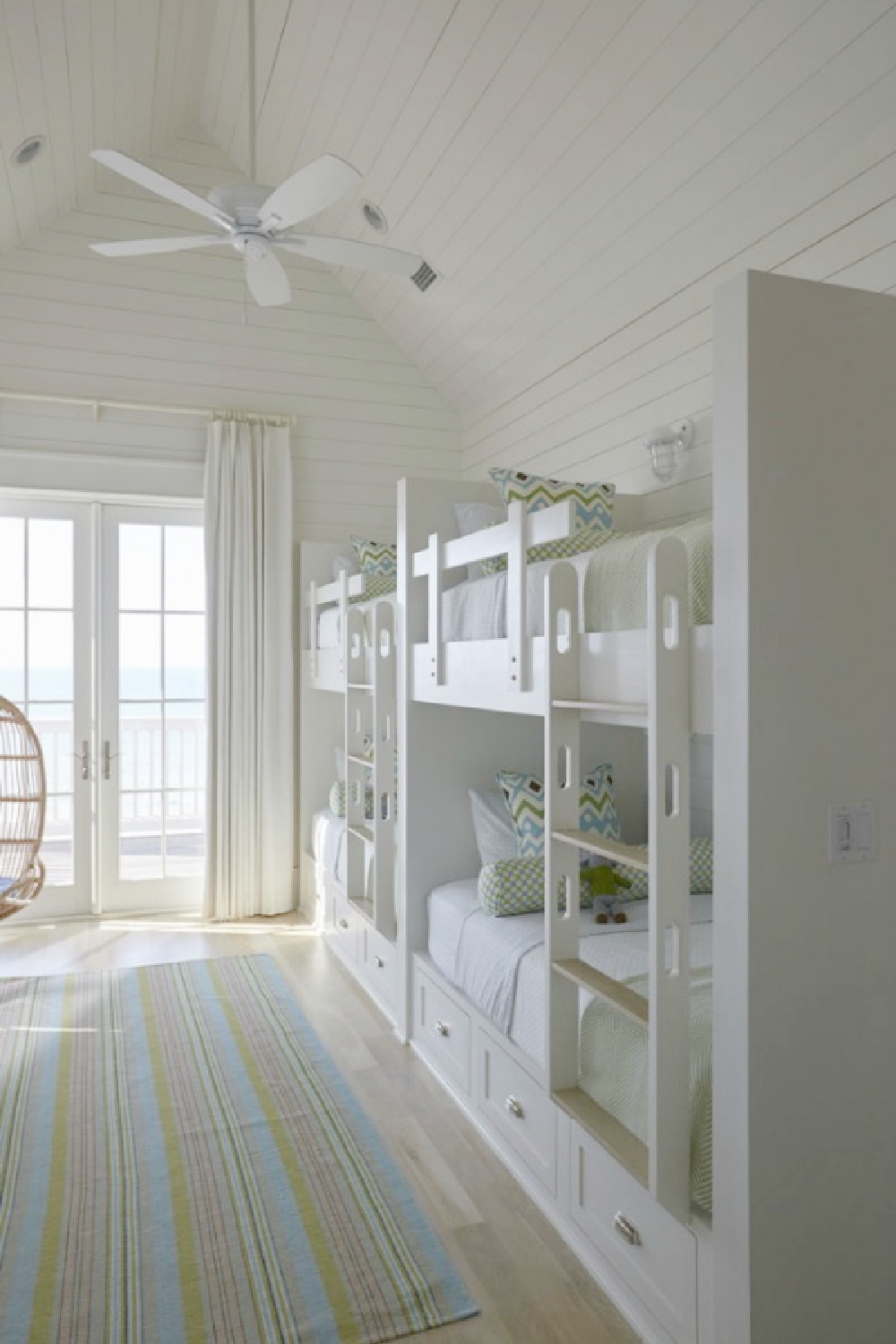 Bunk room with coastal style, built-ins, and shiplap walls and ceilings - Geoff Chick. #bunkrooms #coastalstyle #builtinbunks