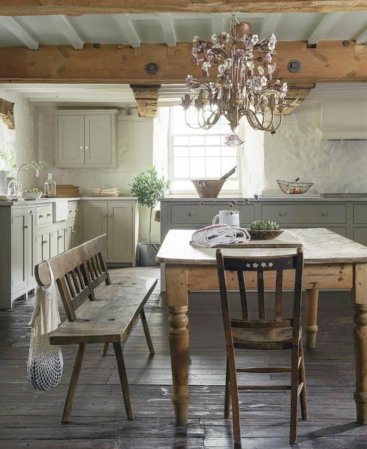 Beautifully rustic English country kitchen in the UK by deVOL has Shaker style cabinetry, farm sink, and a serene palette. #european country #englishcountry #countrykitchen #kitchendesign #rustickitchen #frenchkitchen #shakerkitchen