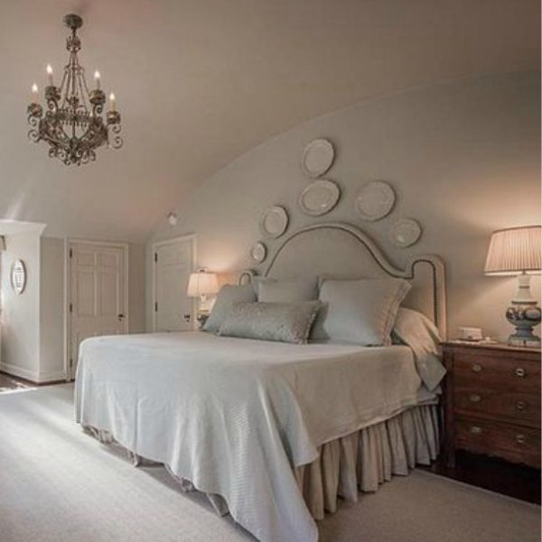 Romantic French bedroom with plates on wall in an elegant historic home with Old World style and beautifully classic European inspired interiors in Marietta Georgia was built for the Kennedy-DuPre family. . See more  English Tudor Interior Design Inspiration from this European Country Master Suite & Dining Room Design Inspiration on Hello Lovely Studio.