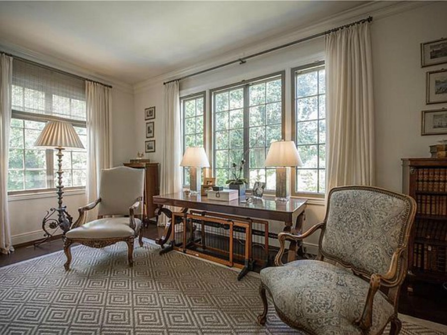 Elegant historic home with Old World style and beautifully classic European inspired interiors in Marietta Georgia was built for the Kennedy-DuPre family. ee more of the Entry, Living Room & Kitchen Design Inspiration As Well As Photos of a Beautiful Georgia Tudor Exterior on Hello Lovely Studio.
