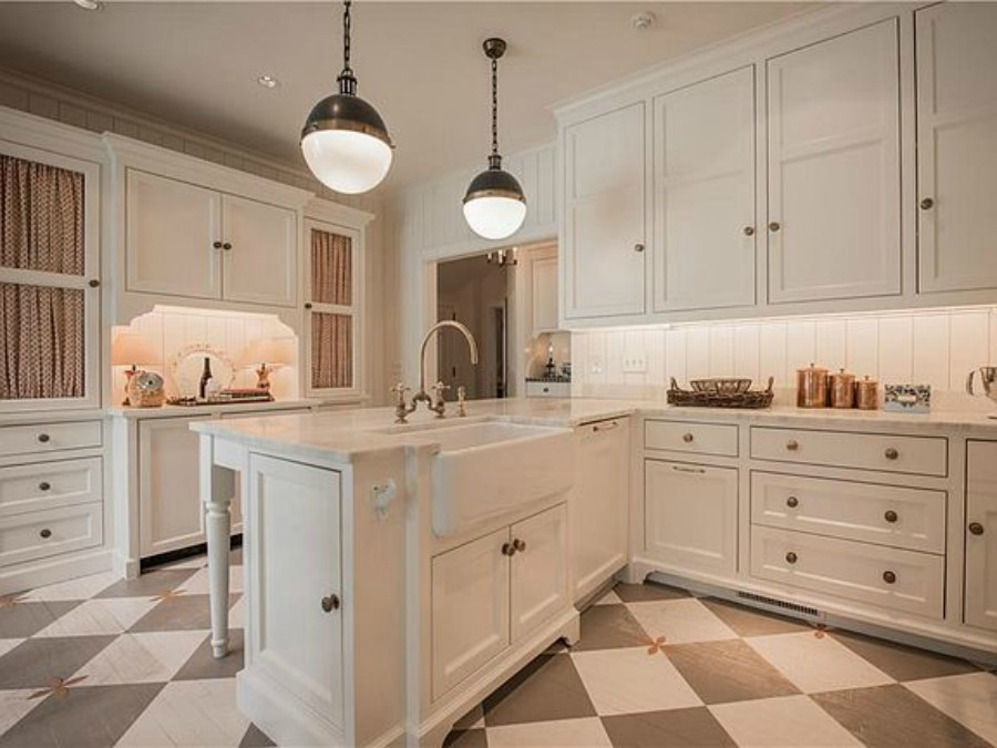 Checkered wood floor in beautiful French country kitchen of an elegant historic home with Old World style and beautifully classic European inspired interiors in Marietta Georgia was built for the Kennedy-DuPre family. ee more of the Entry, Living Room & Kitchen Design Inspiration As Well As Photos of a Beautiful Georgia Tudor Exterior on Hello Lovely Studio.