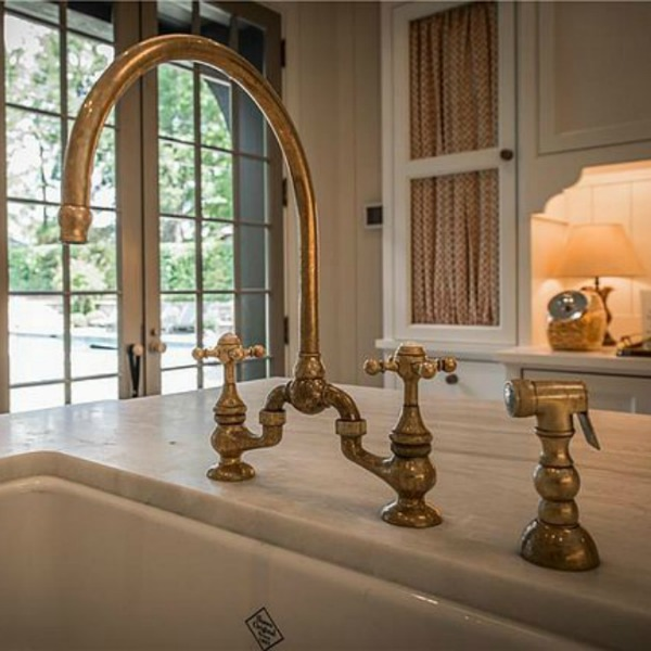 Detail of brass bridge faucet in kitchen of an elegant historic home with Old World style and beautifully classic European inspired interiors in Marietta Georgia was built for the Kennedy-DuPre family. See more in Traditional Style House Tour: 1935 English Tudor on Hello Lovely Studio.