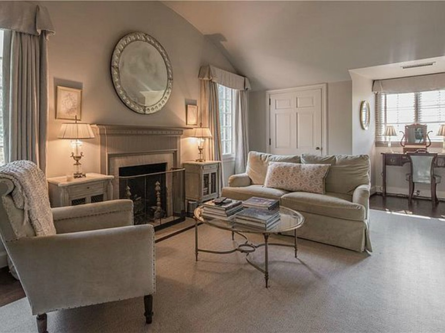 Sitting room in bedroom with fireplace in an elegant historic home with Old World style and beautifully classic European inspired interiors in Marietta Georgia was built for the Kennedy-DuPre family.. See more  English Tudor Interior Design Inspiration from this European Country Master Suite & Dining Room Design Inspiration on Hello Lovely Studio.